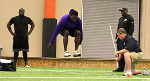 Clifton Rhodes III performs the broad jump drill. || BRAD KEITH/TheFlashToday.com