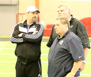 Tarleton State football head coach Cary Fowler visits with regional scouts from the Panthers and Rams during a pro day event at Aledo High School Wednesday. || BRAD KEITH/TheFlashToday.com