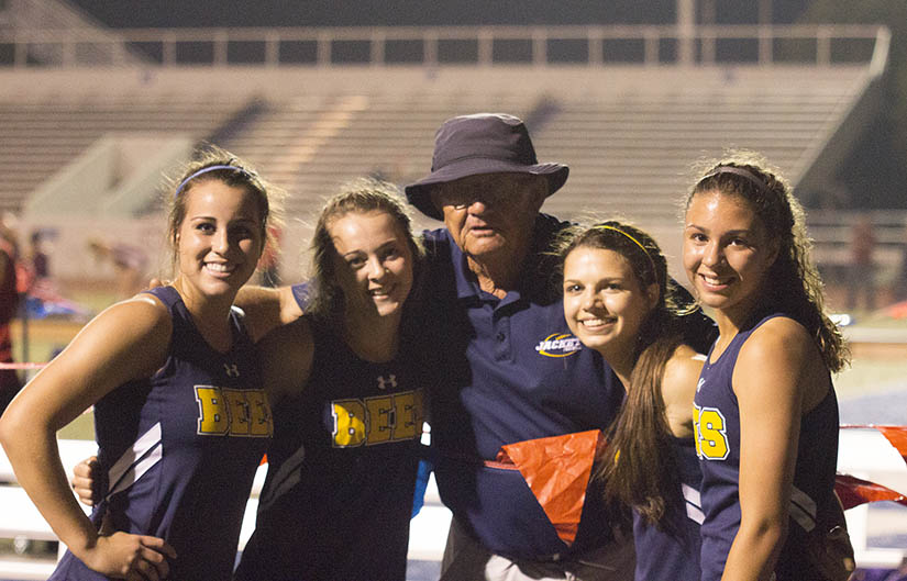 Legendary coach Mike Copeland with victorious members of his 4x400-meter relay team. || Courtesy Dr. CHET MARTIN