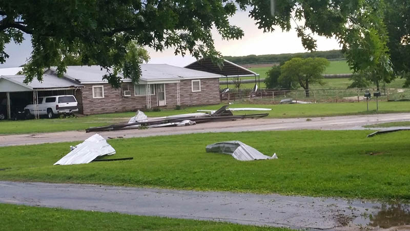 A portion of the roof of a western Erath County dairy barn was torn off by Friday's dangerously high winds. || Courtesy SUSAN KEITH/Gotcha Photos