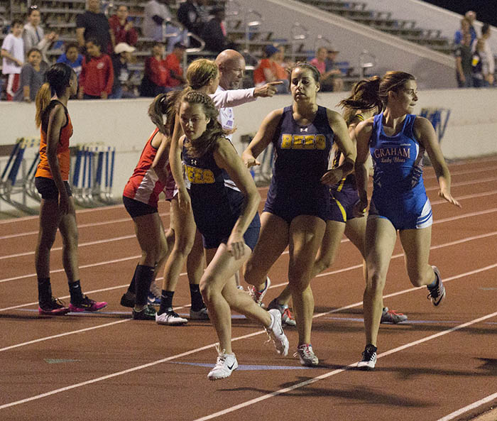 Mikayla Hobbs hands the baton to Cassidy Cline during the 4x400-meter relay. || Courtesy Dr. CHET MARTIN