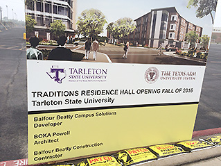 This is the construction sign standing in the southwest corner of what for years has been the home parking lot to Memorial Stadium. By the Fall of 2016, it will be Traditions Residence Hall. || Photo by BRAD KEITH/TheFlashToday.com
