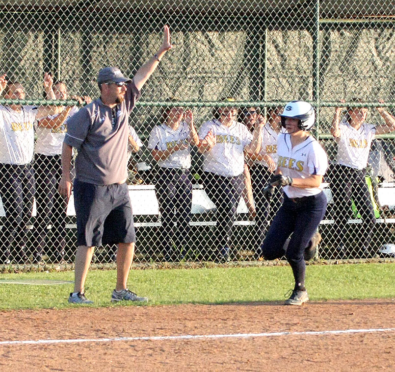 Stephenville head coach Rus Mayes sends one runner home while stopping another at second in the first inning of a 9-4 victory over Abilene Wylie Tuesday at McCleskey Field in Stephenville City Park.