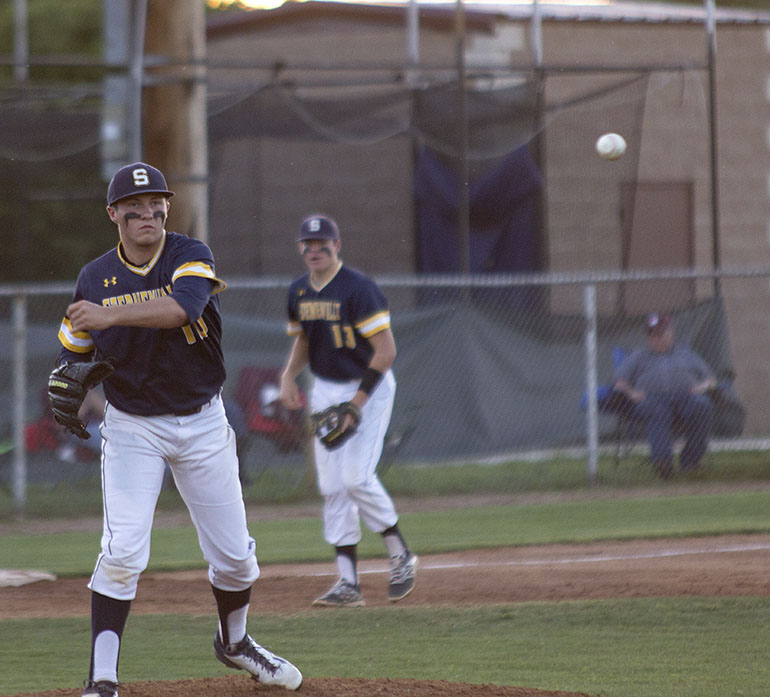 Winning pitcher Josh Bulla flips the ball to first for an out during his complete-game pitching performance Wednesday. The Stephenville senior struck out nine and allowed just four hits. || Courtesy Dr. CHET MARTIN