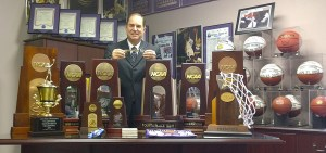 Tarleton athletic director and men's basketball head coach Lonn Reisman displays the assortment of NCAA Division II and Lone Star Conference trophies won by Tarleton State athletic teams in 2014-15. He is is holding a key to the city of Stephenville, presented to him in April by Mayor Kenny Weldon. || BRAD KEITH/TheFlashToday.com