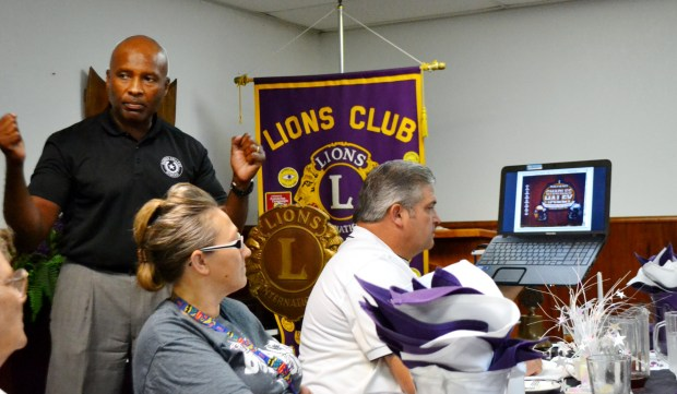 New Ranger College Dean of Developmental Education Dr. Calvin Lawrence speaks to members of the Ranger Lions Club about attending the 2015 NFL Hall of Fame induction ceremony in Canton, Ohio, on Aug. 8. Lawrence attended the ceremony as the guest of former San Francisco and Dallas star Charles Haley. Lawrence and Haley, both natives of Virginia, were college teams at James Madison University in 1982. (Photo courtesy of Ranger College/Tommy Wells)