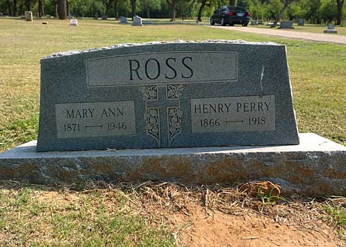 This headstone is already located in an area clearly affected by drainage.