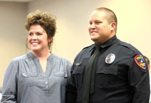 New Stephenville Police officer Barrett Joiner, a Dublin native, was sworn in and had his badge pinned on by his wife, Danielle. || Photo by BRAD KEITH