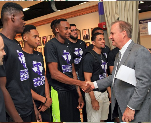 Chancellor Sharp is greeted by members of the Tarleton Texan men's basketball team during a brief tour of Wisdom Gym.