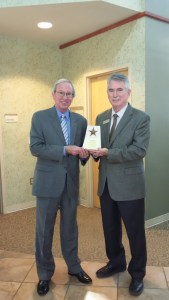 Don McBeath (left) with the Texas Organization of Rural & Community Hospitals presenting the award to State Representative J.D. Sheffield.