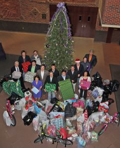 Members of Alpha Gamma Rho Fraternity and representatives of Tarleton State University's Office of Student Engagement, President F. Dominic Dottavio and Vice President for Student Life Dr. Laura Boren pose with just a portion of the nearly 600 gifts collected as part of this year's Lil Texan & TexAnn Angel Tree Project. A total of 140 children in the Cross Timbers area will receive the gifts that were collected and donated by Tarleton students, faculty and staff.