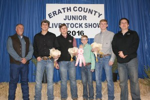 Bailey Fenn won reserve champion in the poultry division with these pullets that were purchased by Evening Lions Club and Rockin' D Hydraulic Services for $2,000.