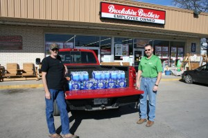 John Forson, left, administrator and founder of the Erath County Breaking News Facebook page, picks up recently donated bottles of water from Michael Beard, store manager at Brookshire Brothers in Dublin. Forson plans to distribute the cases of water to volunteer fire departments across Erath County on February 20.