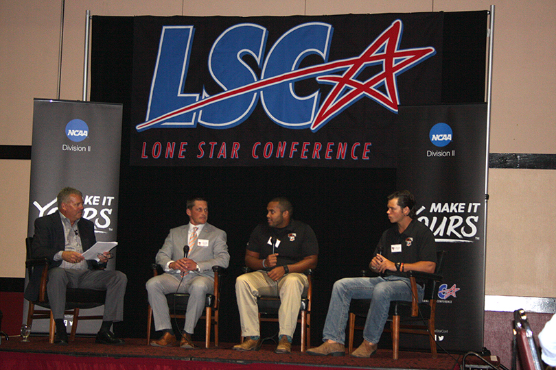 Justin Carrigan, second from left, is head coach at Texas-Permian Basin, a startup program, after previously serving as offensive coordinator at Tarleton. Carrigan is seated beside Jared Thames, a Glen Rose native and defensive lineman who transferred to UTPB from Tarleton. || TheFlashToday.com photo by BRAD KEITH