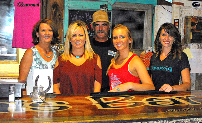The Greenwood Saloon staff includes (left to right) booking agent Jan Morris, owner Julie Neuneker, owner Bryan Newton, Hannah Marie Linteau and Ciara Reese. || TheFlashToday.com photo by DAVID SWEARINGEN
