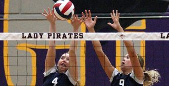 Taylor Garber, left, and Nicona Stilwell go up to attempt a block for Stephenville Tuesday. || TheFlashToday.com photo by BRAD KEITH