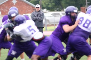 Head coach Todd Whitten keeps a close eye on his team's progress during a team offense vs. defense session to end a preseason practice at Tarleton. || TheFlashToday.com photo by BRAD KEITH