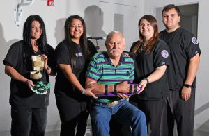 Stephenville resident Clarence Young (center) surrounded by Tarleton State University Kinesiology students (l-r) Bailee Mauldin, Elizabeth Cisneros, Brianna Evartt and Dexter Vaughn. Young, age 71, received his custom-fit orthotic this week that was produced by undergraduate student Christina Tocquigny at the university library's Maker Spot. The new 3-D printed orthotic replaces his worn homemade brace held by Mauldin.