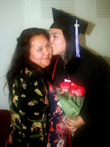 Hedit Hernandez, Ranger grad, kisses her mom after graduation ceremonies this month.