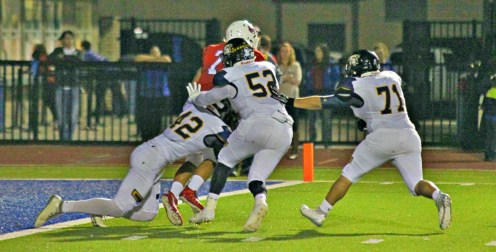 Pacen Parker, 42, and Jonathan Guttierez combine for a sack earlier this season. || The Flash Today photo courtesy Dr. Chet Martin