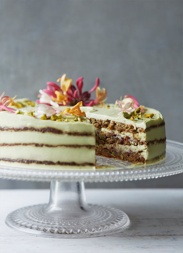 Courgette (zucchini), basil, lime and pistachio cake with avocado lime cream and raspberry jam (jelly) from Clean Cakes by Henrietta Inman, photography by Lisa Linder. Published by Jacqui Small