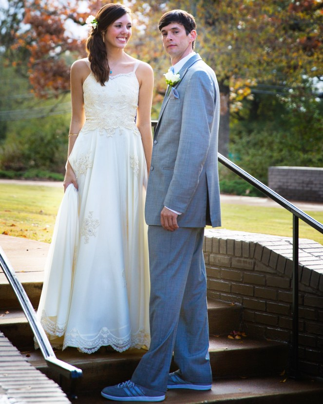 happy married couple wedding day vintage wedding dress gray suit wedding sneakers