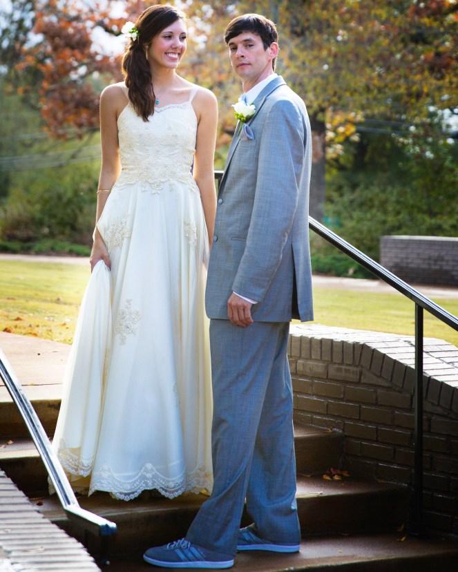 happy married couple wedding day vintage wedding dress gray suit wedding sneakers