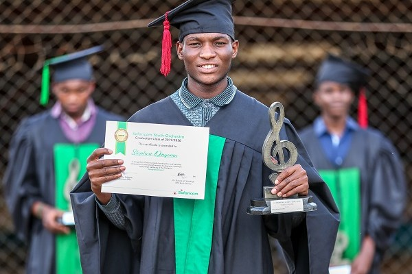 Stephen Ongoma, a graduate of the Safaricom Youth Orchestra during its 6th graduation ceremony that saw thirty students graduating in a virtual ceremony. Stephen plays the Violin.