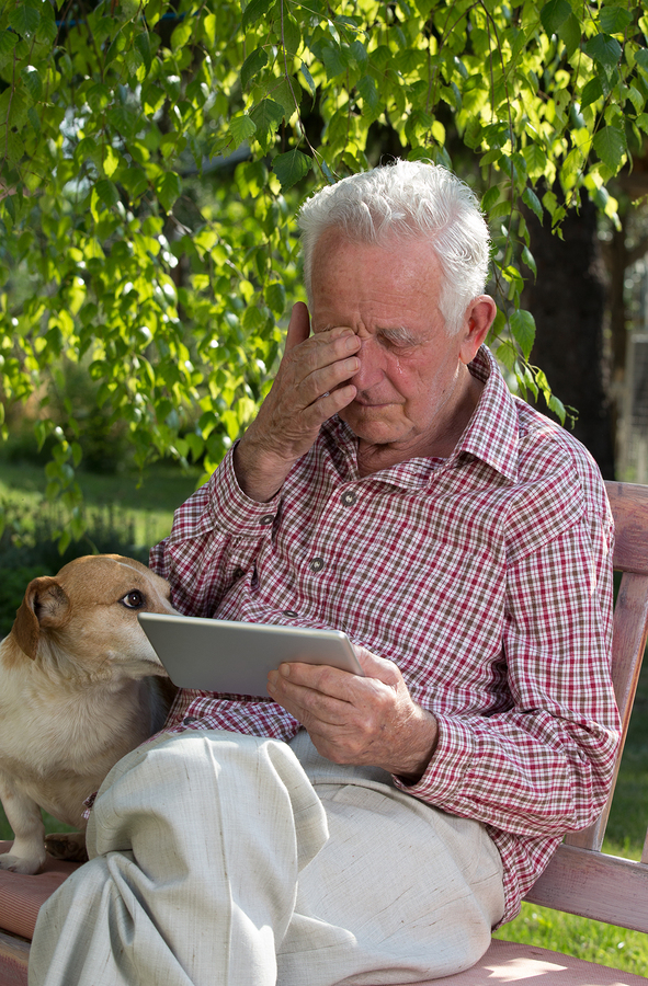 Old Man With Dog And Tablet Crying In Garden | The Flow Center