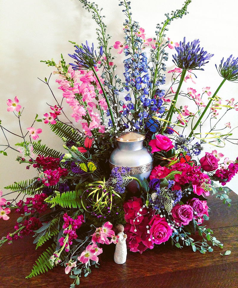 Sympathy Arrangement in Urn with Purple and Pink Flowers