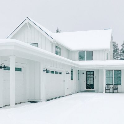 White Farmhouses Covered In Snow