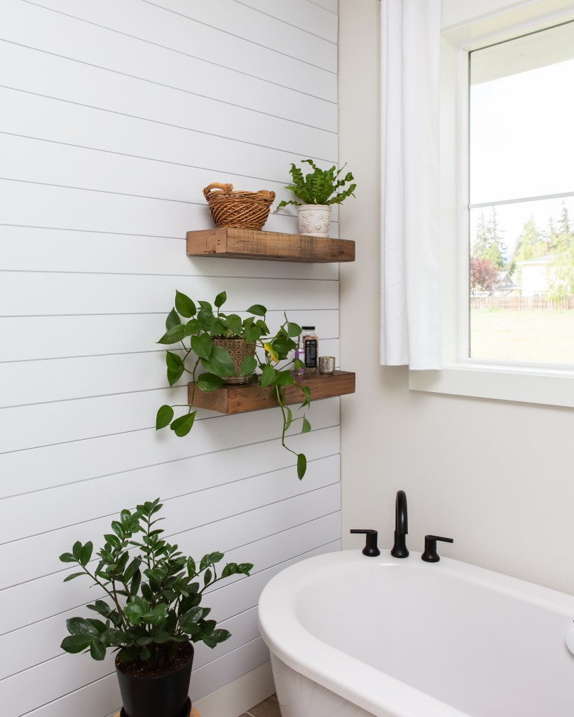 shiplap accent wall with rustic floating shelves