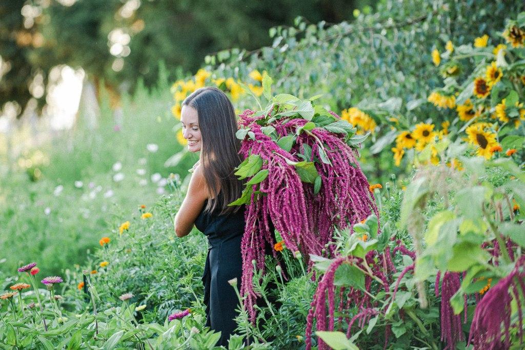 1st year flower farmer walking through flower field