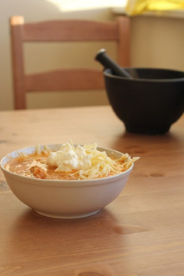 Mexican Chicken Soup Loaded with Sour Cream and Shredded Cheese recipe