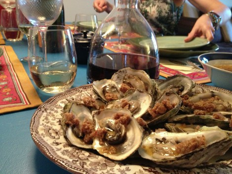 Barbecued oysters on the dinner table with red wine