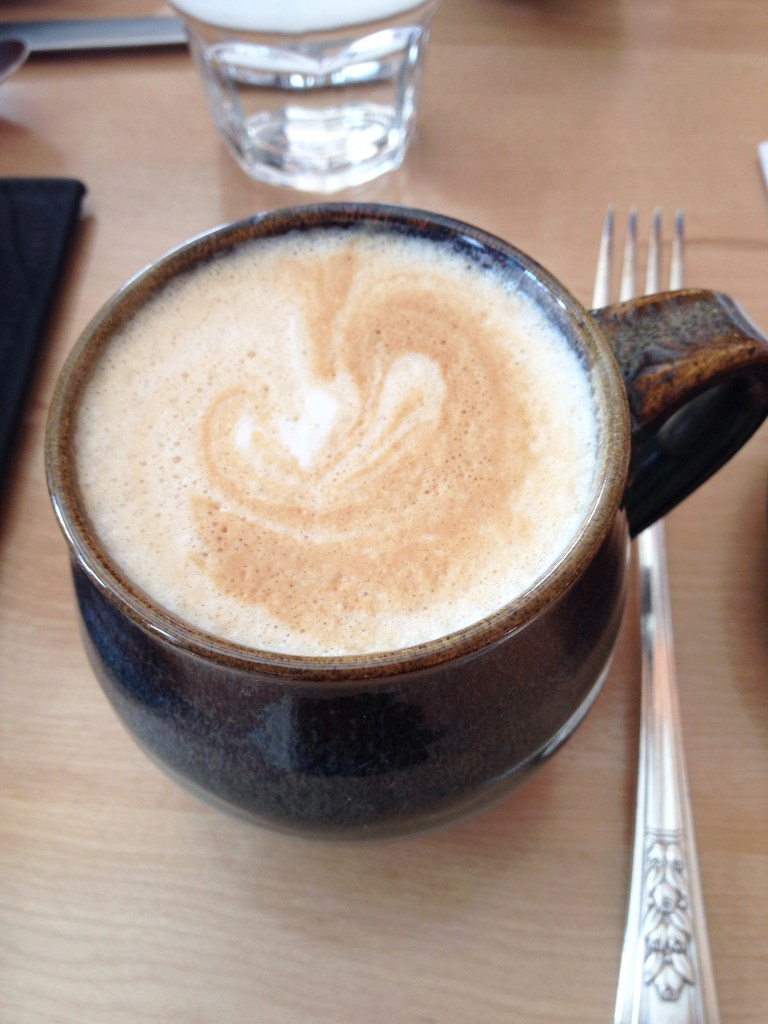 A hot steaming cup of cappucino