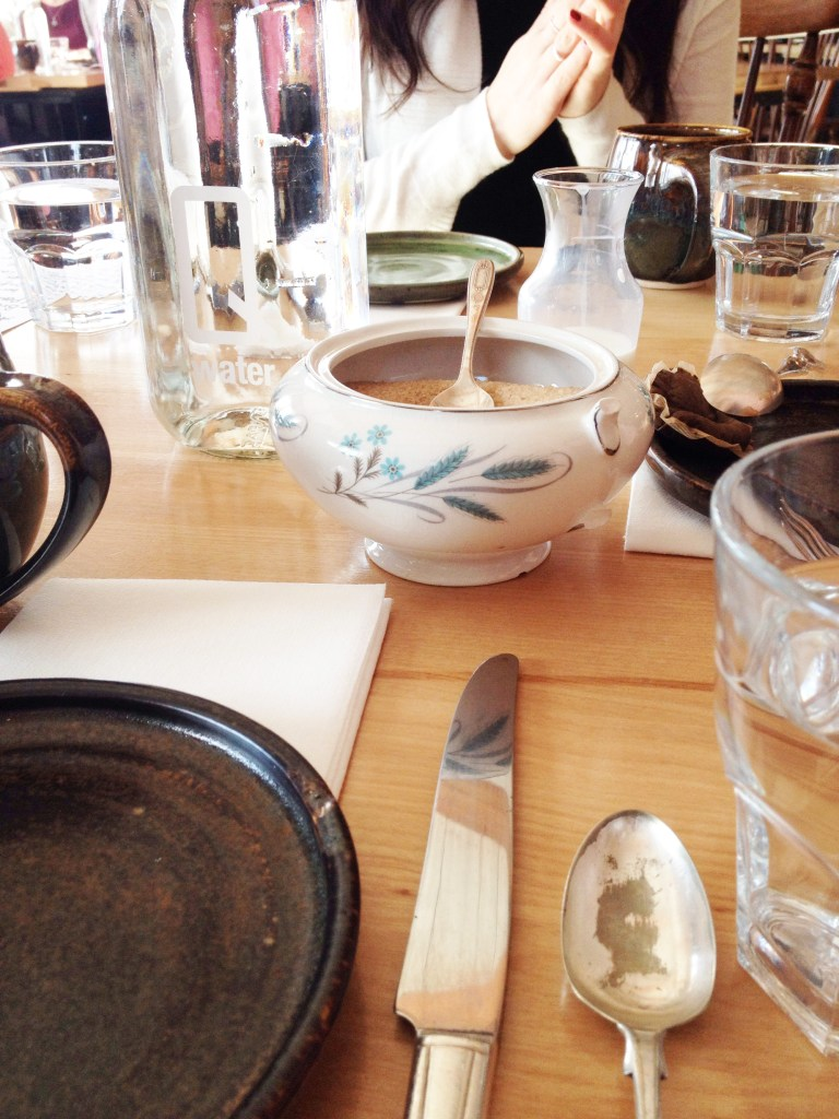 A table set with antique cutlery and pottery at Mallard Cottage restaurant.