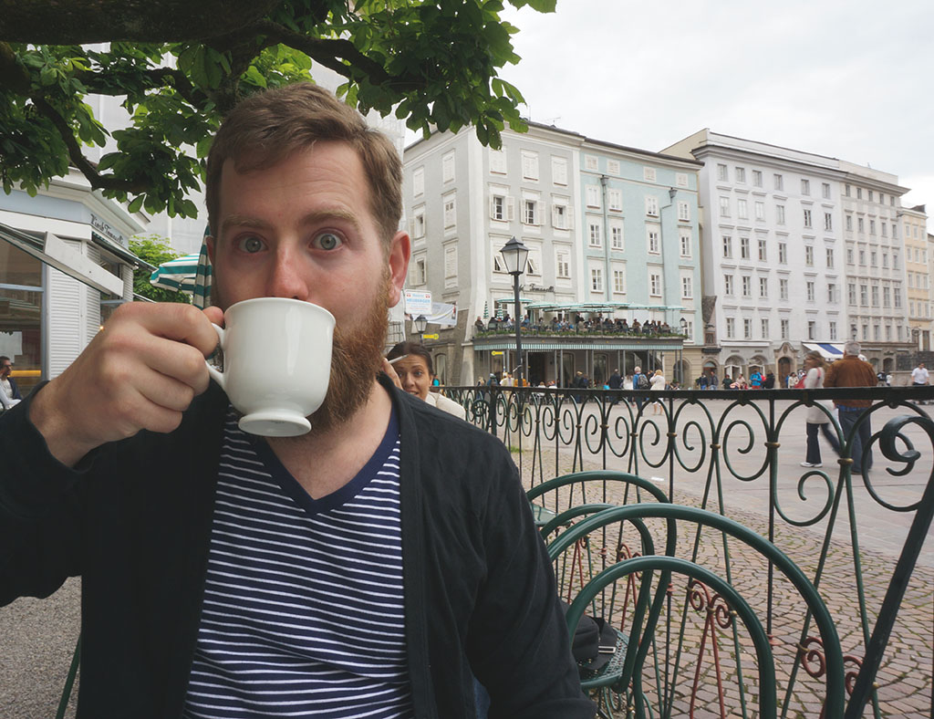Adam drinking hot chocolate at Tomasellis Salzburg