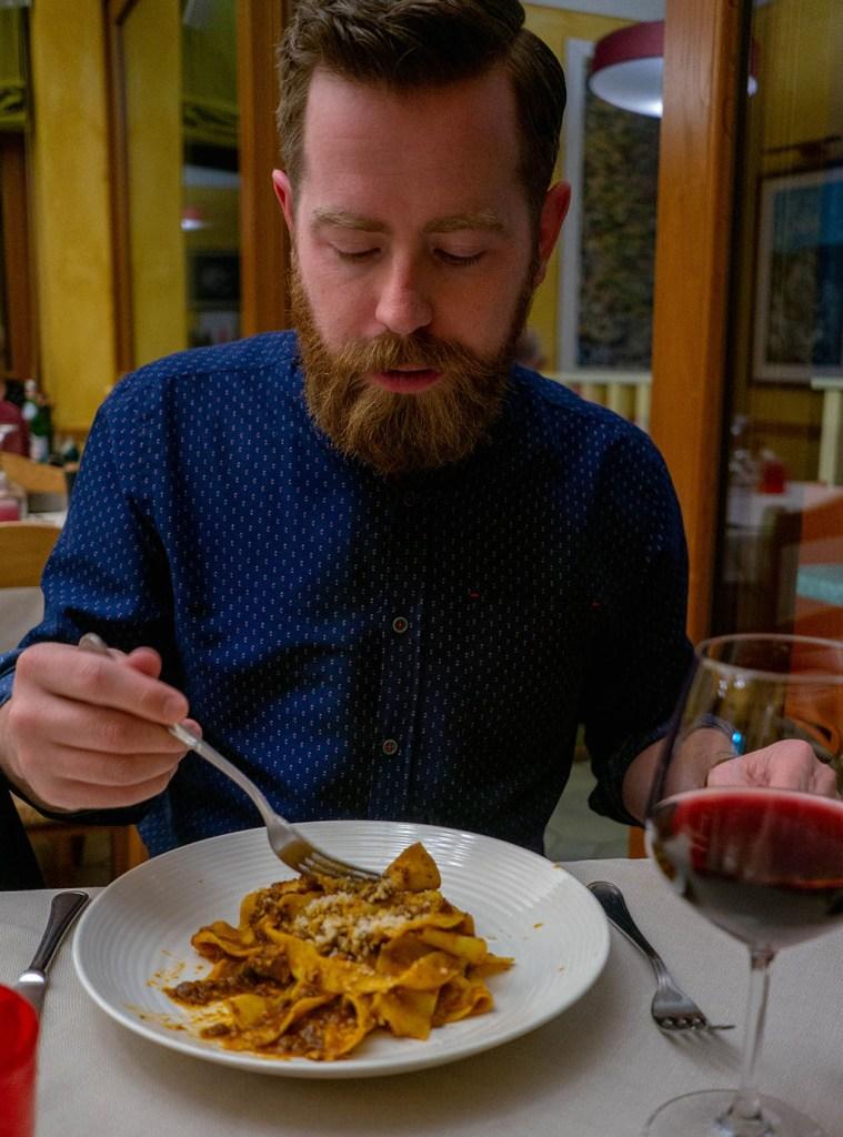 Da Nada Roccatederighi Adam eating bolognese