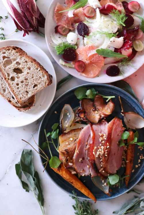 meat dish with grilled vegetables and salad