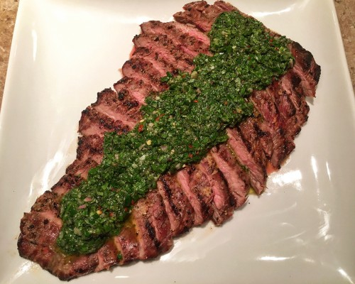 Garlic rubbed, grilled flank steak with chimichurri