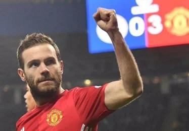 Juan Mata celebrates scoring for Manchester United