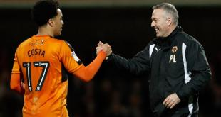 Helder Costa celebrates with Paul Lambert as Wolves get a late winner against Brentford