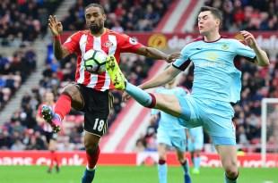 Michael Keane and Jermain Defoe battle for the ball as Sunderland host Burnley