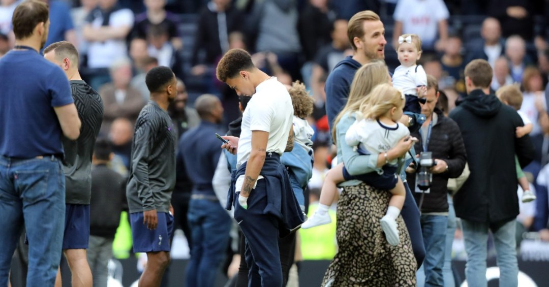 Dele Alli looking at his phone