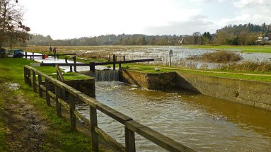 Catteshall Lock overflowing