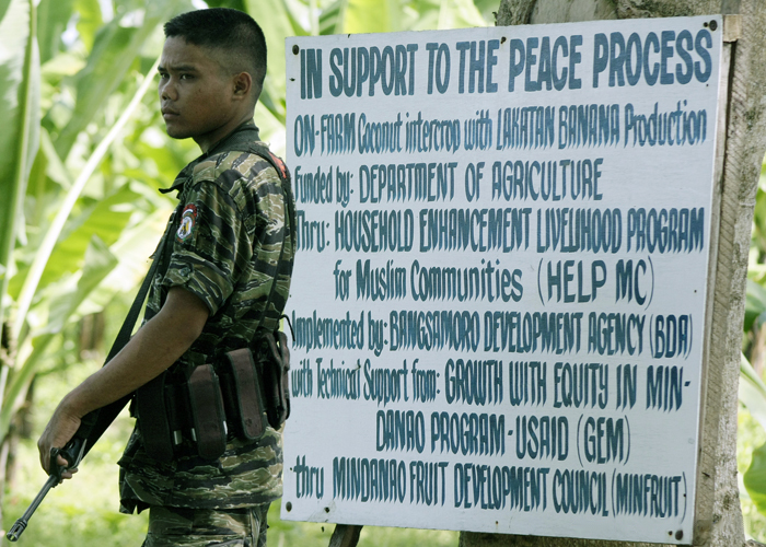 Moro soldier outside MILF camp for USAID project - The Foreign Analyst