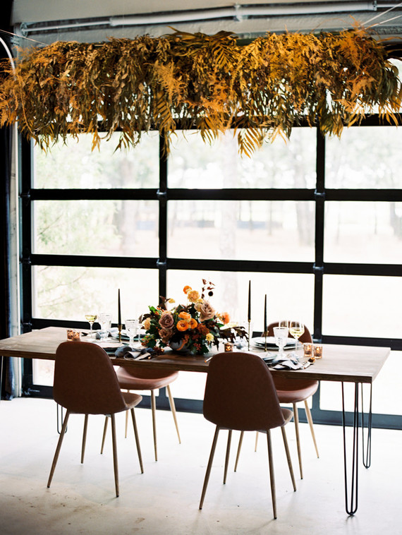 Minimal and modern chairs and furniture embellished by warm fall florals decorated the modern fall wedding theme
