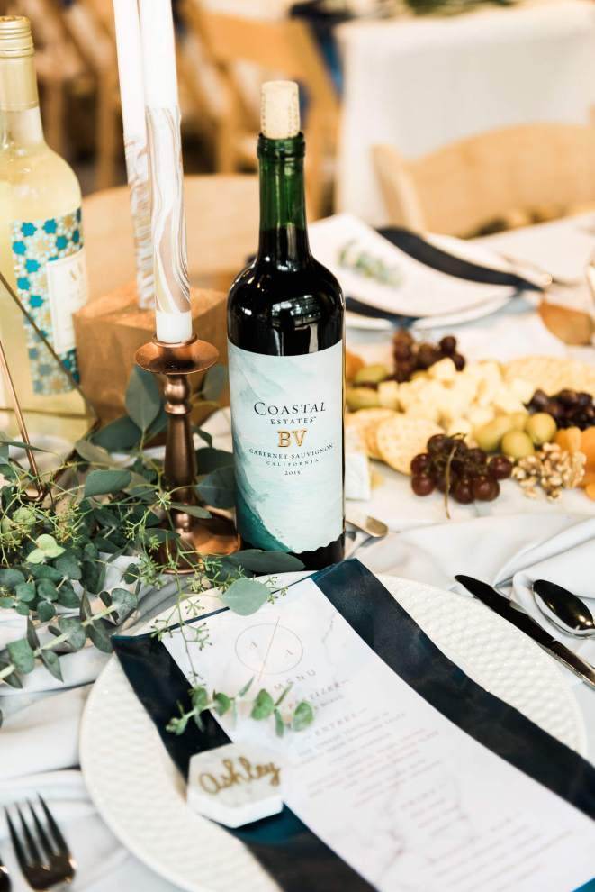 The table featured wine and decadent décor for this elegant summer wedding gala.