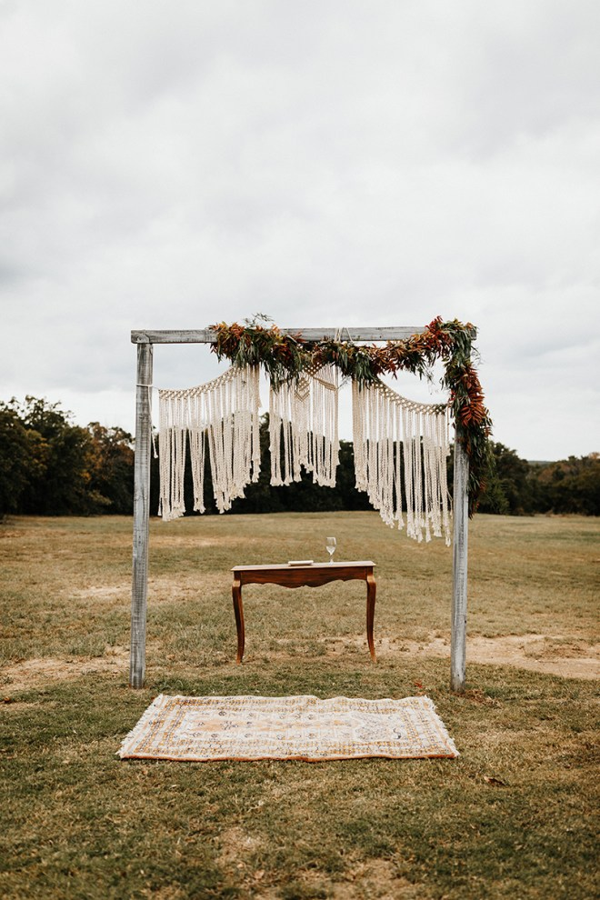 The alter at the end of the aisle, which is located on a sprawling lawn bordered by vinyards for a rustic fall wedding